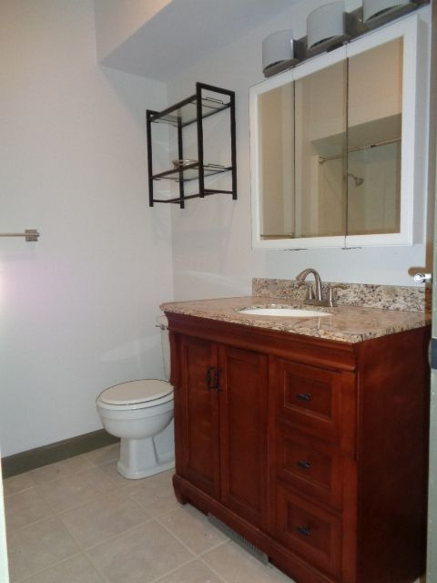 """Full bathroom 6' 6"""" x 7' 10"""" features a new all wood (no particle board or MDF) vanity and vanity top with recessed sink."""