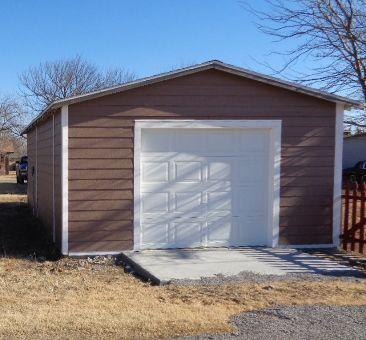 The garage features a new overhead door, new walk-in door and new approach slab.
