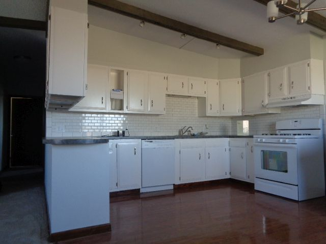 """Kitchen 15' 7"""" x 12' 4"""" (192 sq ft) has ample newly refinished cabinet space."""