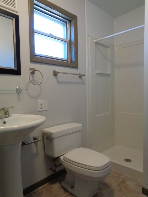 Maser bedroom 3/4 bath (40 sq ft) features new pedestal sink, newly added exhaust fan, and new porcelain tile floor.