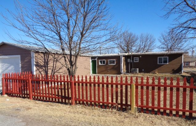 Westhaven back yard features a new cedar French Gothic fence.